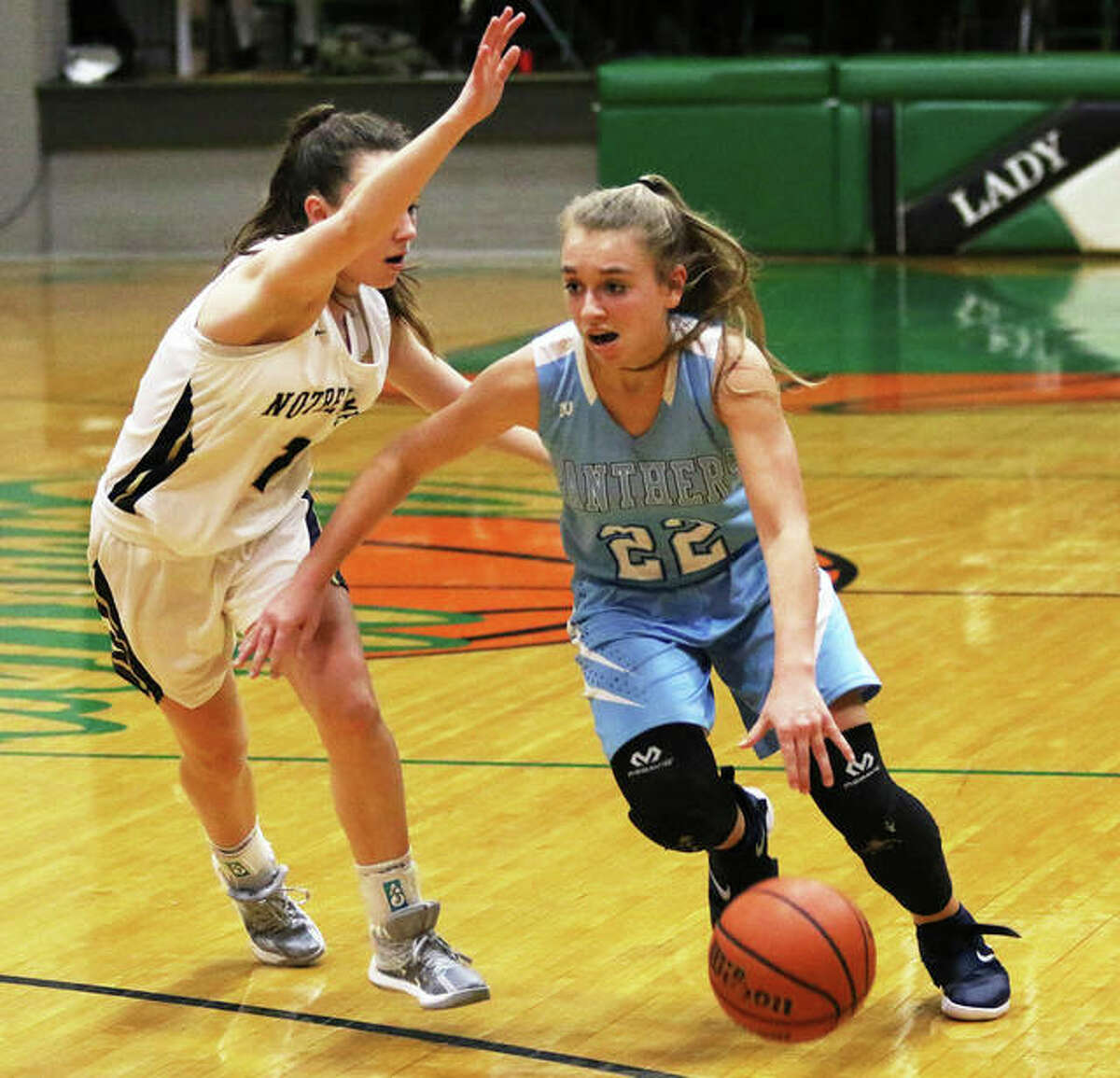 Jersey's Clare Breden (right), shown driving past a Quincy Notre Dame defender last season at the Carrollton Tourney, earned MVP honors Saturday night while leading the Panthers to the title of the Alton Tip-Off Classic.