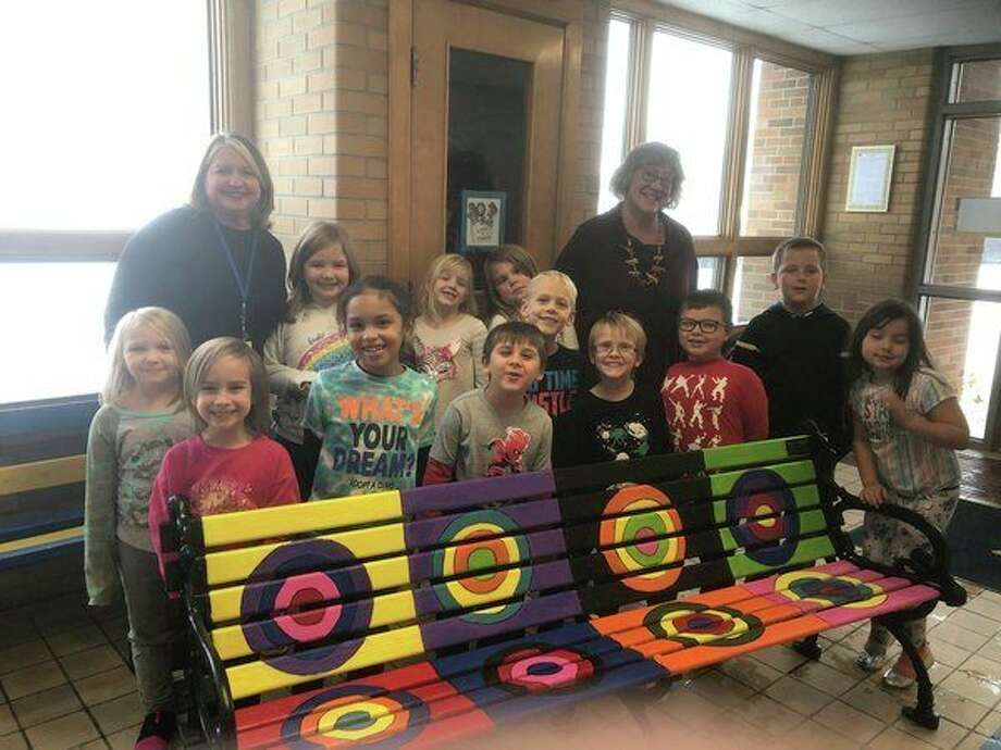 Teachers Lynn Williams and Mary Wahr, along with students from Jefferson Elementary, present the finished bench inspired by Wassily Kandinsky. The bench is now located outside the Ramsdell Theatre. (Courtesy photo)