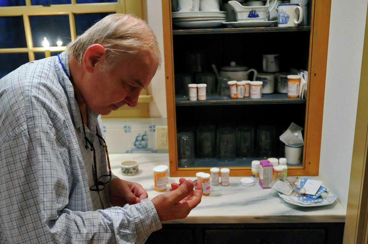 Retired WNYT Channel 13 anchor Ed Dague with some of the many medications he has to take, as he talks about his new memoir,