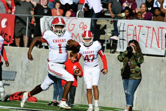 Crosby junior quarterback Reggie Branch (1) outruns the Huntsville defense to the Hornet's end zone for a touchdown on a running play in the 2nd quarter of their Region III-5A Area Round matchup at Randall Reed Stadium in New Caney on Nov. 23, 2019.