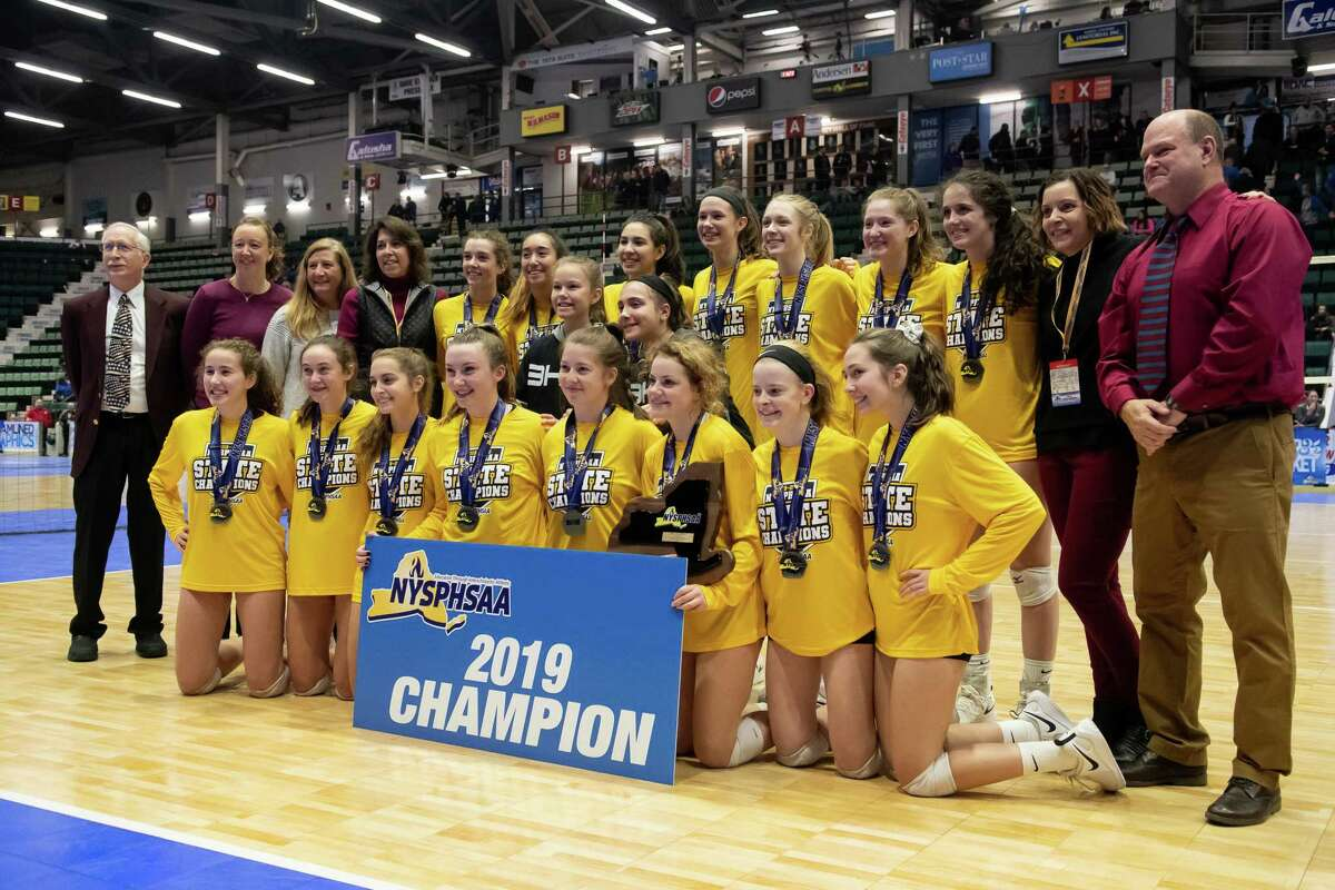 Burnt Hills players, coaches, and staff pose for a photograph following the team's victory in the Class A State Championship against West Irondequoit on Sunday, Nov. 24, 2019, at Cool Insuring Arena in Glens Falls, N.Y. (Jenn March, Special to the Times Union)