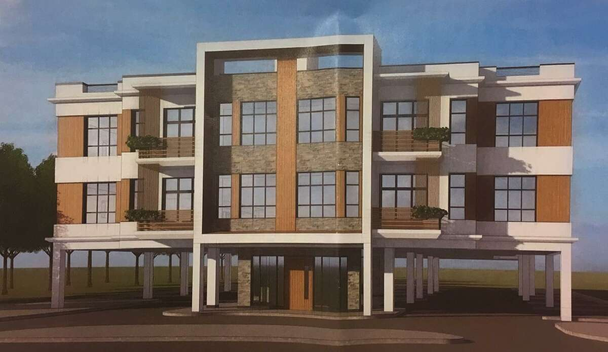 """The proposed three-story building would have 20 apartments in 23,328 square feet of residential space, along with 42 parking spaces. Four of the apartment units would be set aside as below the market rate for """"moderate-income"""" residents."""