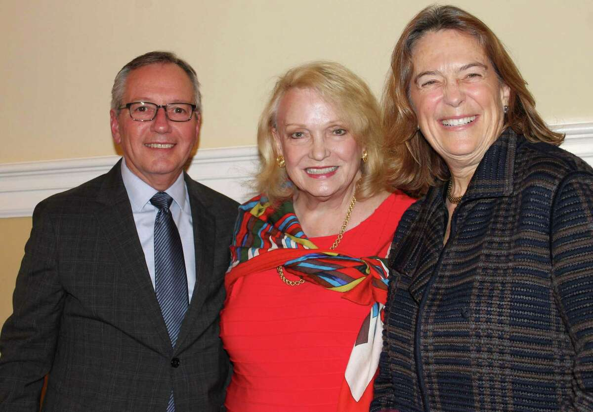 Mary Moran, right, is honored with the 2019 Helen Gratz Rockefeller Outstanding Volunteerism Award from Family Centers. She is with Family Centers' CEO Bob Arnold and former Board Chair Jan Dilenschneider.