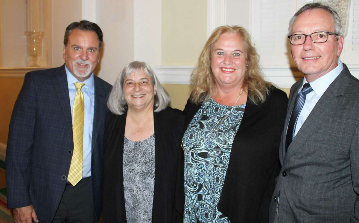 The 2019 Family Champion award winners Lisa Coppotelli, second from left, and Helene Cote, second from right. They are with Family Centers CEO Bob Arnold, right, and Dennis Torres, left, Family Centers' VP of health care.