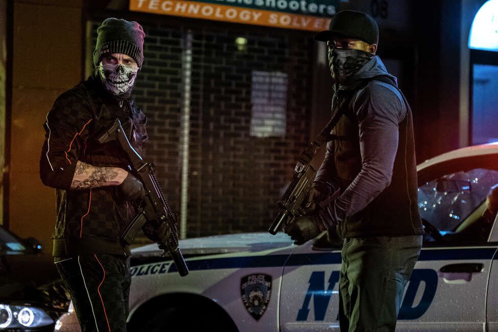 This image released by STXfilms shows Taylor Kitsch, left, and Stephan James in a scene from
