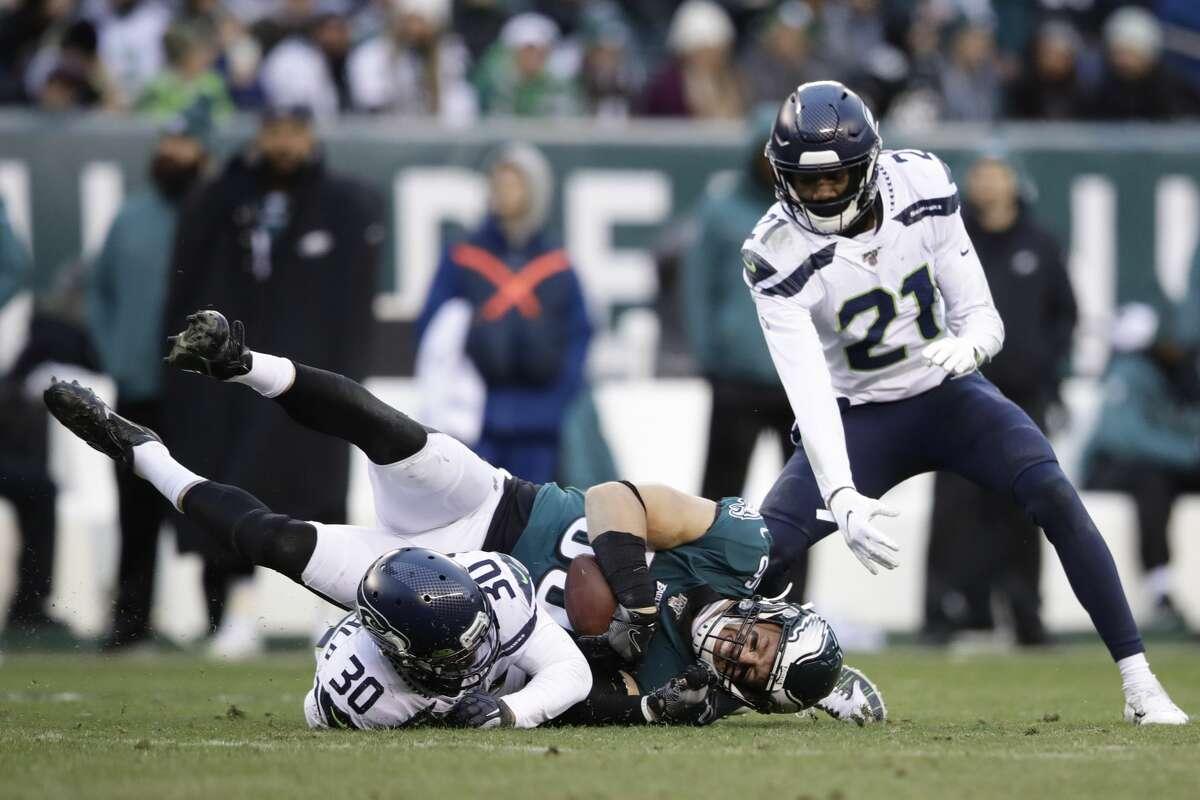 Philadelphia Eagles' Zach Ertz (86) is tackled by Seattle Seahawks' Bradley McDougald (30) during the second half of an NFL football game, Sunday, Nov. 24, 2019, in Philadelphia. (AP Photo/Matt Rourke)