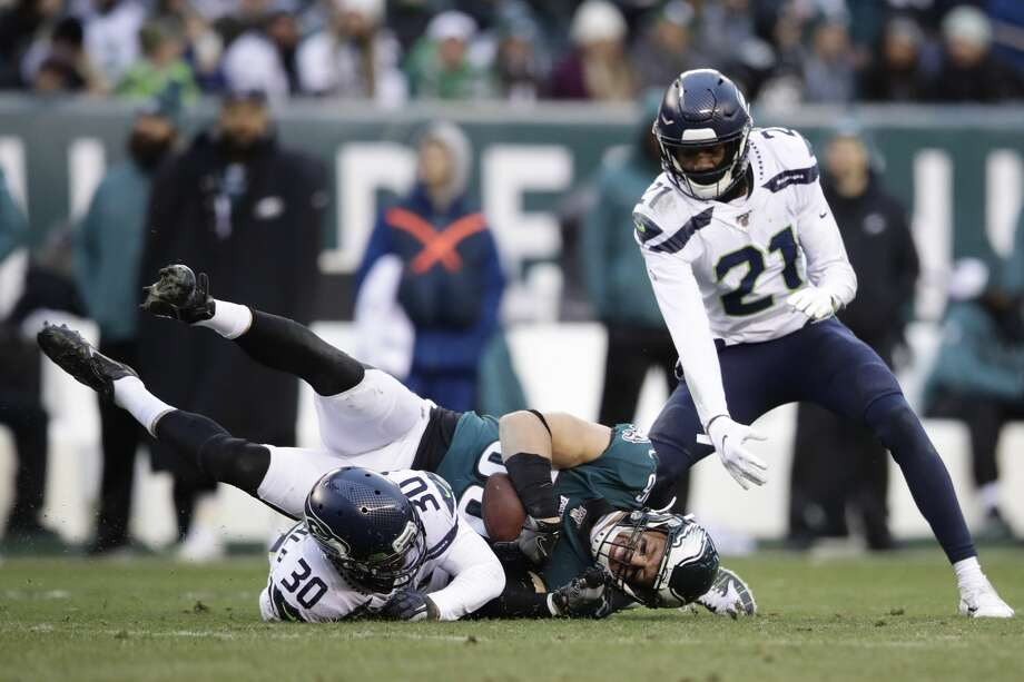 Philadelphia Eagles' Zach Ertz (86) is tackled by Seattle Seahawks' Bradley McDougald (30) during the second half of an NFL football game, Sunday, Nov. 24, 2019, in Philadelphia. (AP Photo/Matt Rourke) Photo: Matt Rourke/AP