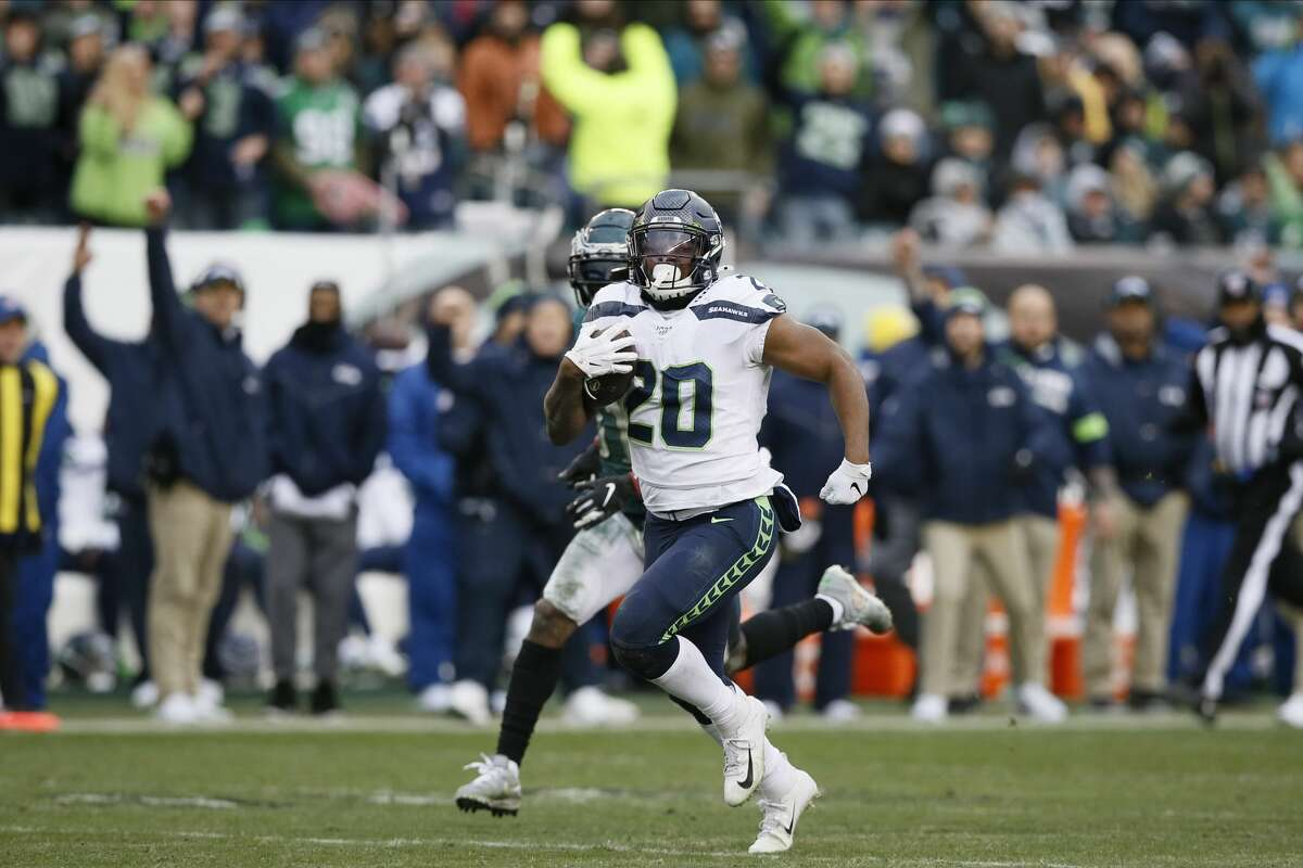 Seattle Seahawks' Rashaad Penny (20) runs for a touchdown during the second half of an NFL football game against the Philadelphia Eagles, Sunday, Nov. 24, 2019, in Philadelphia. (AP Photo/Michael Perez)