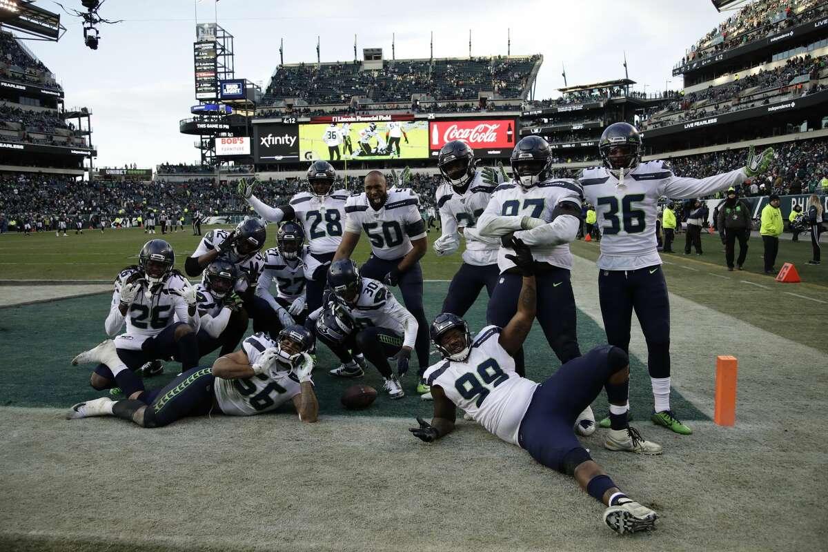 Seattle Seahawks defensive players celebrate during the second half of an NFL football game against the Philadelphia Eagles, Sunday, Nov. 24, 2019, in Philadelphia. (AP Photo/Matt Rourke)