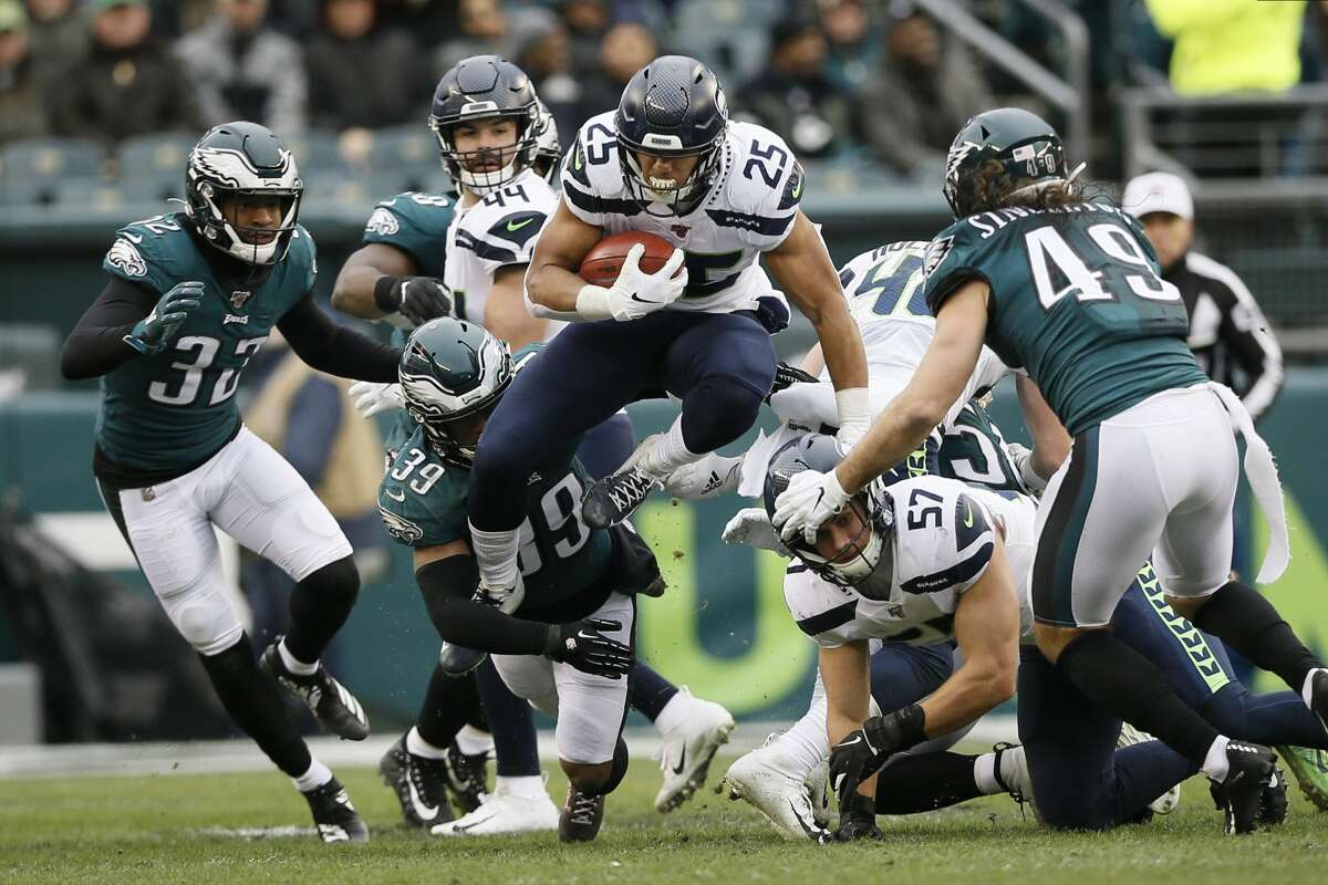 Seattle Seahawks' Travis Homer plays during the second half of an NFL football game against the Philadelphia Eagles, Sunday, Nov. 24, 2019, in Philadelphia. (AP Photo/Michael Perez)