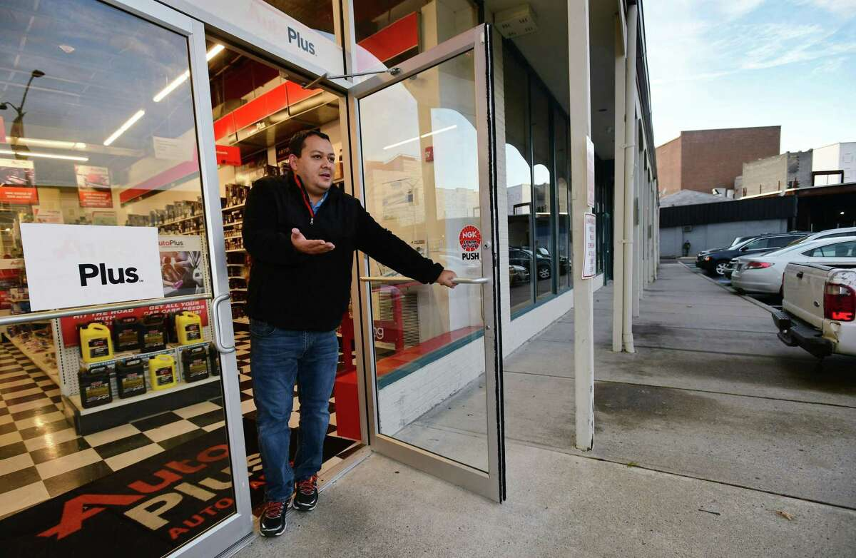 Businesses owners along Isaac Street and the adjacent parking lot like Arnold Coello, owner of Auto Plus, complain about the blocked entrance to the lot in Norwalk.