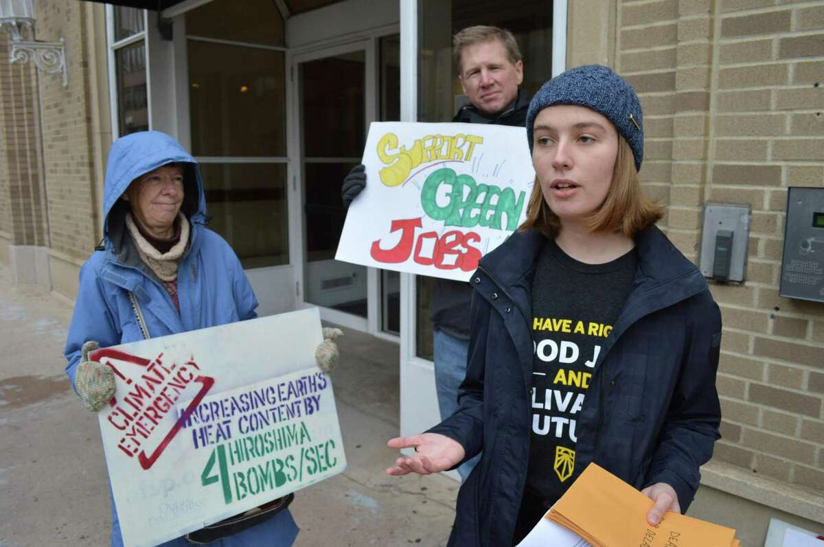 Nora Heaphy, right, stands outside U.S. Rep. Rosa DeLauro's office preparing to send a letter to the congresswoman calling for support on a new environmental proposal.