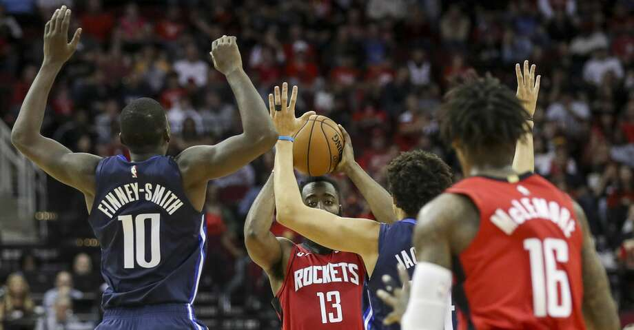 Houston Rockets guard James Harden (13) looks to pass to guard Ben McLemore (16) during the first quarter of an NBA basketball game at the Toyota Center on Sunday, Nov. 24, 2019, in Houston. Photo: Jon Shapley/Staff Photographer