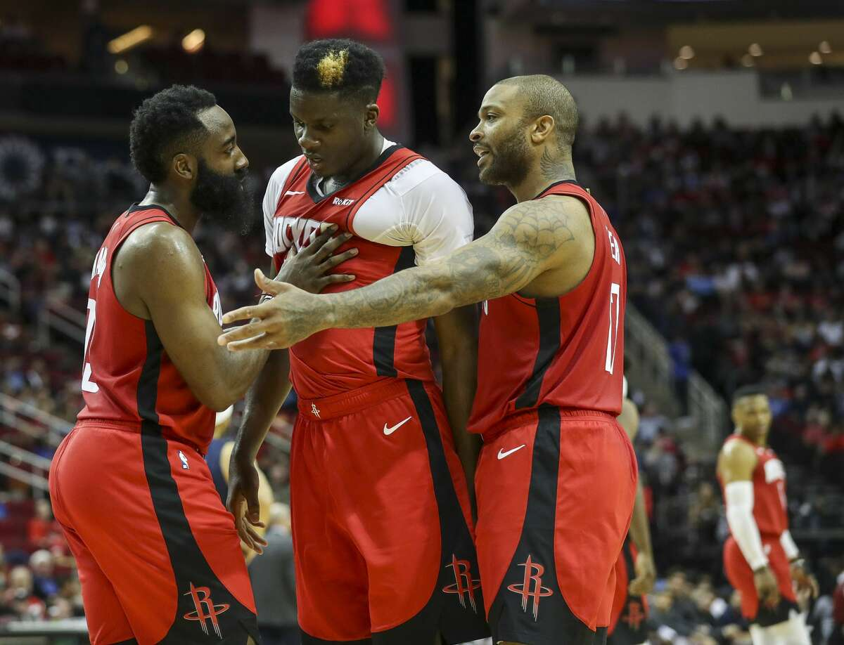 Houston Rockets guard James Harden (13) and forward PJ Tucker (17) talk to center Clint Capela (15) during the second quarter of an NBA basketball game at the Toyota Center on Sunday, Nov. 24, 2019, in Houston.
