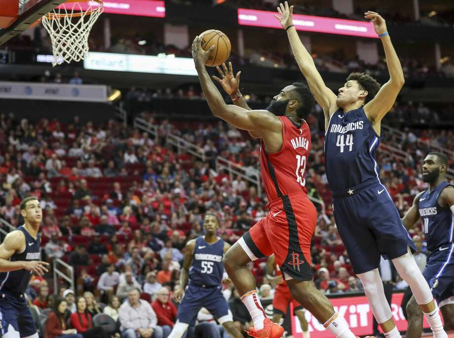 Houston Rockets guard James Harden (13) gets by Dallas Mavericks forward Justin Jackson (44) on his way to the basket during the second quarter of an NBA basketball game at the Toyota Center on Sunday, Nov. 24, 2019, in Houston. Photo: Jon Shapley/Staff Photographer