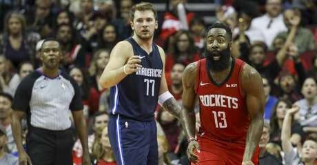 Houston Rockets guard James Harden (13) reacts to a call as Dallas Mavericks forward Luka Doncic (77) watches during the third quarter of an NBA basketball game at the Toyota Center on Sunday, Nov. 24, 2019, in Houston.