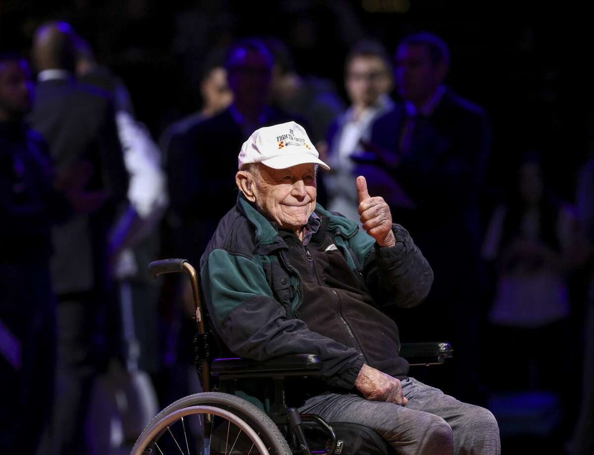Chuck Yeager is cheered by fans during a break in play during the second quarter of an NBA basketball game at the Toyota Center on Sunday, Nov. 24, 2019, in Houston. Yeager is a former U.S. Air Force ace and test pilot.