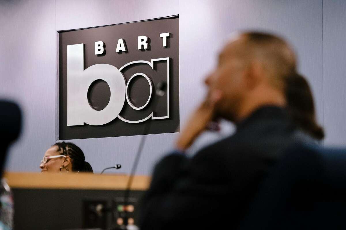 A sign hangs above board members during a BART meeting in Oakland, California, Monday, November 21, 2019.