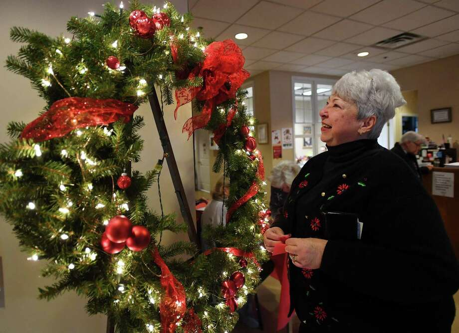 Nancy Valentine, of Ansonia, puts in tickets for the raffle of a large holiday wreath at the second annual Festival of Trees event at the Shelton Senior Center in Shelton on Sunday. Photo: Brian A. Pounds / Hearst Connecticut Media / Connecticut Post