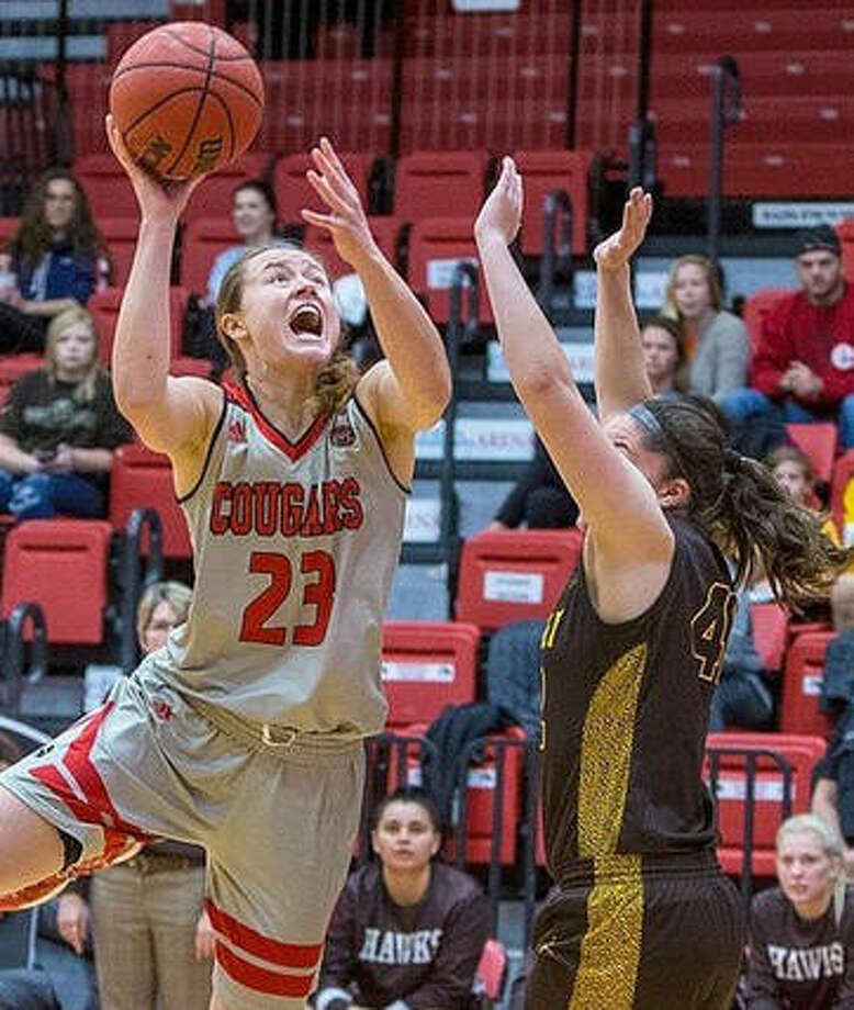 SIUE's Allie Troeckler (23), shown putting up a shot in the lane in a game earlier this season in Edwardsville, scored 10 points Sunday to lead the Cougars in a loss at Missouri. Photo: Scott Kane / SIUE Athletics