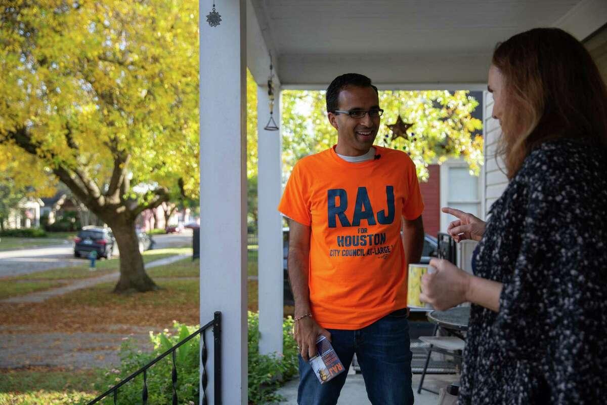 Houston City Council candidate Raj Salhotra chats with Carol Denson during a campaign block walk through a north Houston neighborhood on Nov. 24, 2019.