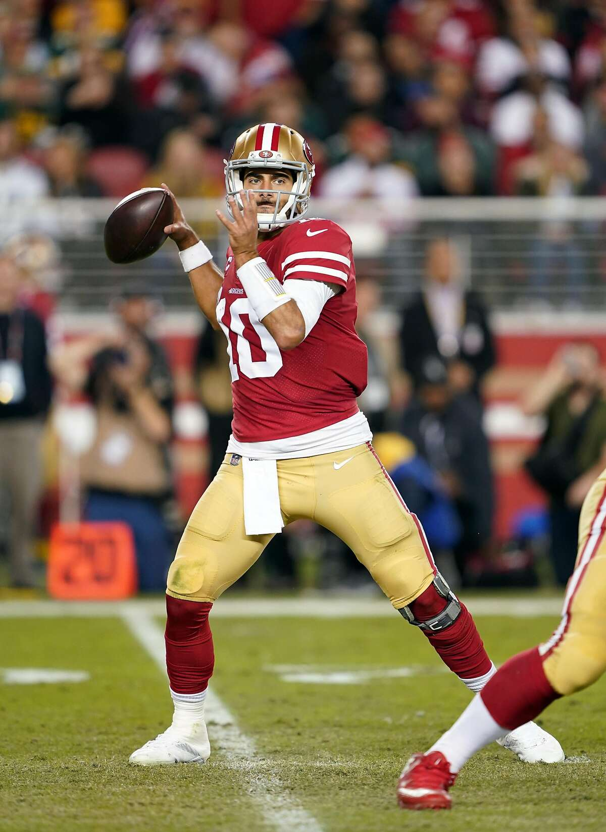 Quarterback Jimmy Garoppolo #10 of the San Francisco 49ers looks to pass during the first half of the game against the Green Bay Packers at Levi's Stadium on November 24, 2019 in Santa Clara, California.