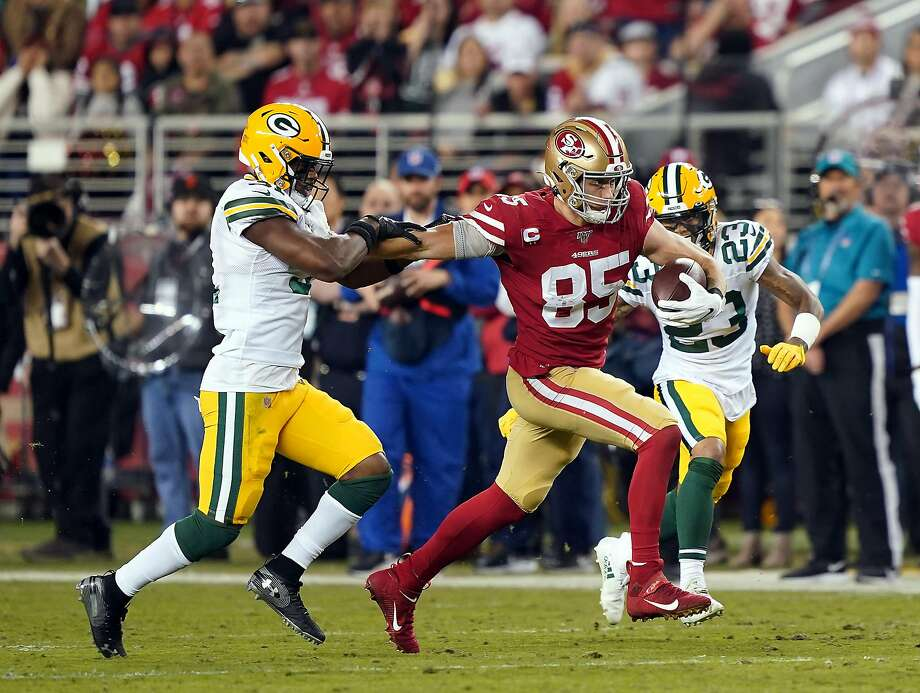 Tight end George Kittle #85 of the San Francisco 49ers carries the ball after making a catch as cornerback Jaire Alexander #23 of the Green Bay Packers defends during the first half of the game at Levi's Stadium on November 24, 2019 in Santa Clara, California. Photo: Thearon W. Henderson, Getty Images