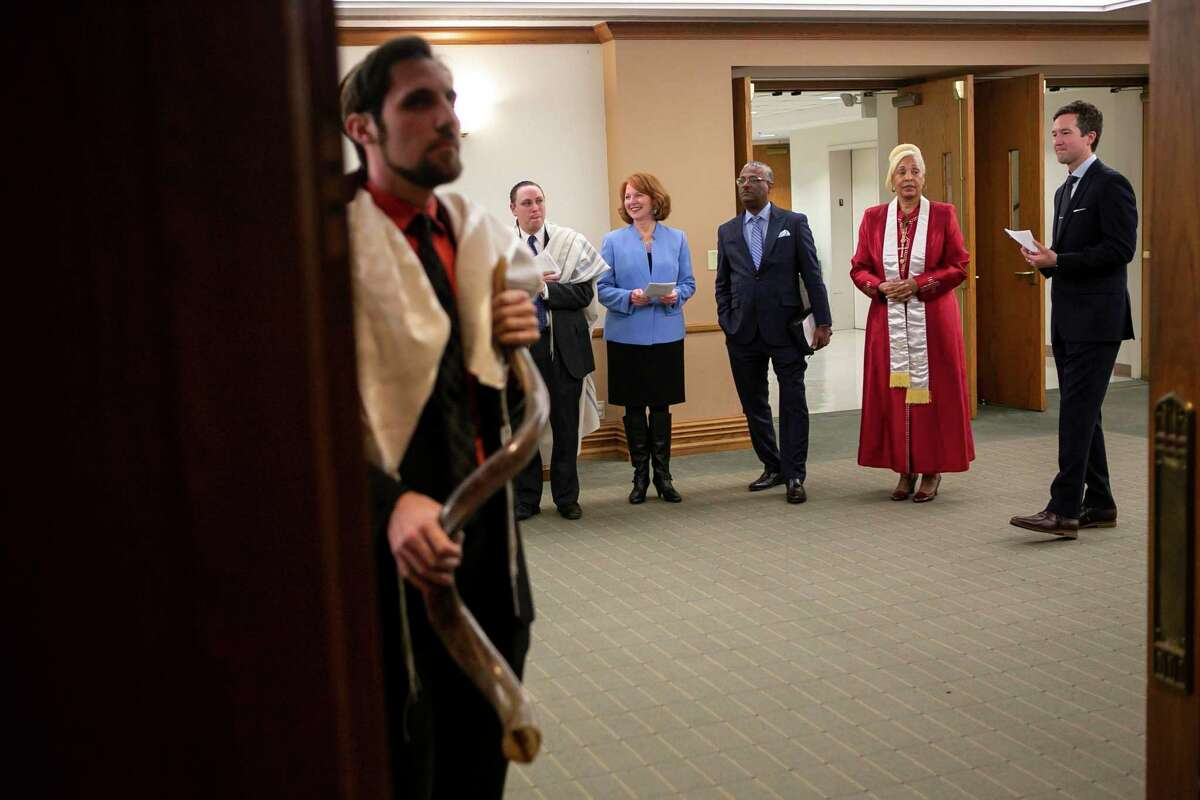 Clergy members line up before entering the sanctuary for the beginning of the 3rd annual Interfaith Thanksgiving service at University Methodist Church in San Antonio, Texas on Nov. 24, 2019. The service was hosted by Woodland Baptist Church, Congregation Agudas Achim, Dialogue Institute of San Antonio and University Methodist Church to bring those of various faiths together to give thanks.