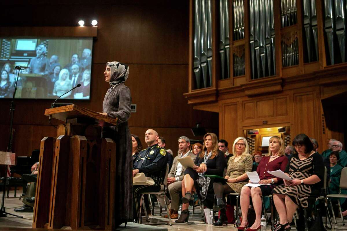 Fulya Seker delivers a prayer for justice during the third annual Interfaith Thanksgiving service at University United Methodist Church in San Antonio on Sunday. The service is meant to start a dialogue.