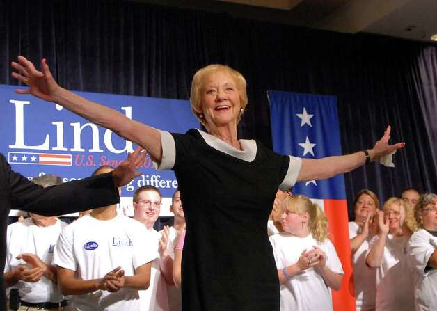 Evelyn Carson, 83, the mother of Linda McMahon, throws her arms up and smiles as she celebrates her daughter's victory in Republican primary for U.S. Senate, Tuesday evening, August 10, 2010, at the Crowne Plaza Hotel, Cromwell, Connecticut. Photo: Bob Luckey / Greenwich Time