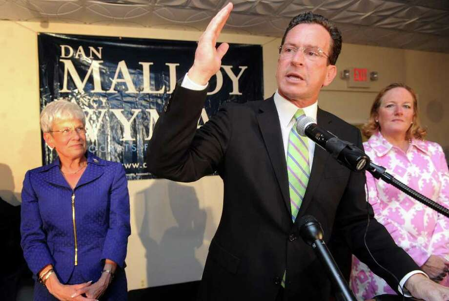 Dan Malloy addresses supporters as running mate Nancy Wyman, left, and wife Cathy Malloy look on Tuesday August 10, 2010 at City Steam Brewery Cafe in Hartford following his victory in the Democratic gubernatorial primary. Photo: Autumn Driscoll / Connecticut Post