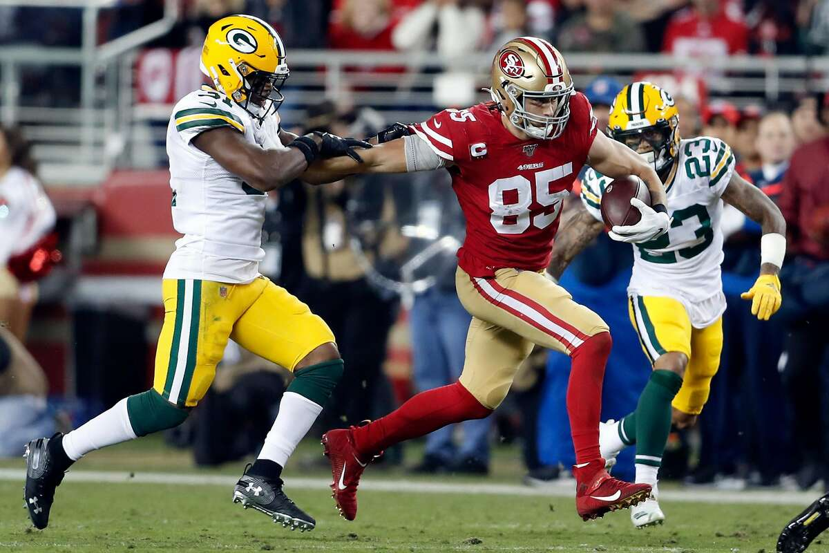 San Francisco 49ers' George Kittle pulls away from Green Bay Packers' Adrian Amos in 2nd quarter during NFL game at Levi's Stadium in Santa Clara, Calif., on Sunday, November 24, 2019.