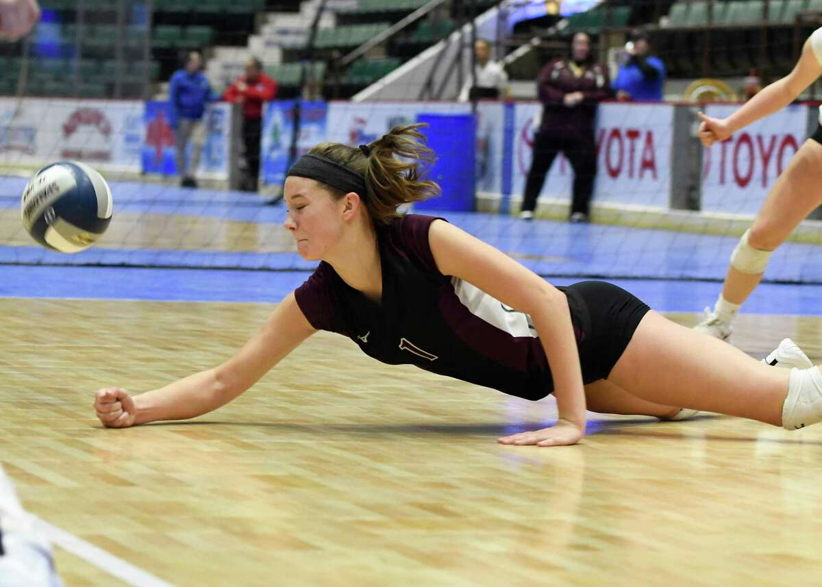 Burnt Hills's Carli Rzeszotarski slides to bump the ball during the Class A State Championship against West Irondequoit on Sunday, Nov. 24, 2019, at Cool Insuring Arena in Glens Falls, N.Y. (Jenn March, Special to the Times Union)