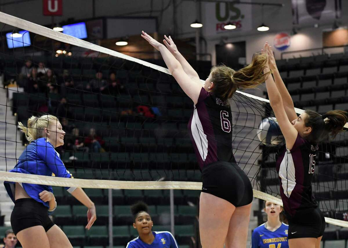 Burnt Hills's Hannah Shell (6) and Callie Chevalier (15) attempt to block a ball spiked by West Irondequoit's Mayleah Tucker during the Class A State Championship on Sunday, Nov. 24, 2019, at Cool Insuring Arena in Glens Falls, N.Y. (Jenn March, Special to the Times Union)