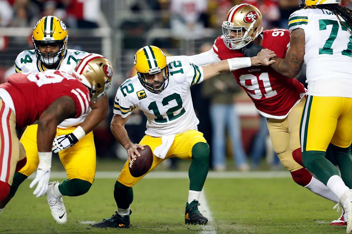 San Francisco 49ers' Arik Armstead pressures Green Bay Packers' Aaron Rodgers before Rodgers fumbled in 1st quarter during NFL game at Levi's Stadium in Santa Clara, Calif., on Sunday, November 24, 2019.