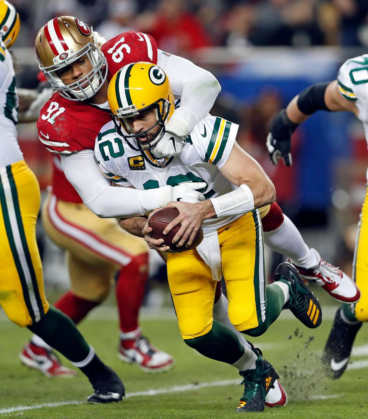 San Francisco 49ers' Arik Armstead sacks Green Bay Packers' Aaron Rodgers in 2nd quarter during NFL game at Levi's Stadium in Santa Clara, Calif., on Sunday, November 24, 2019.