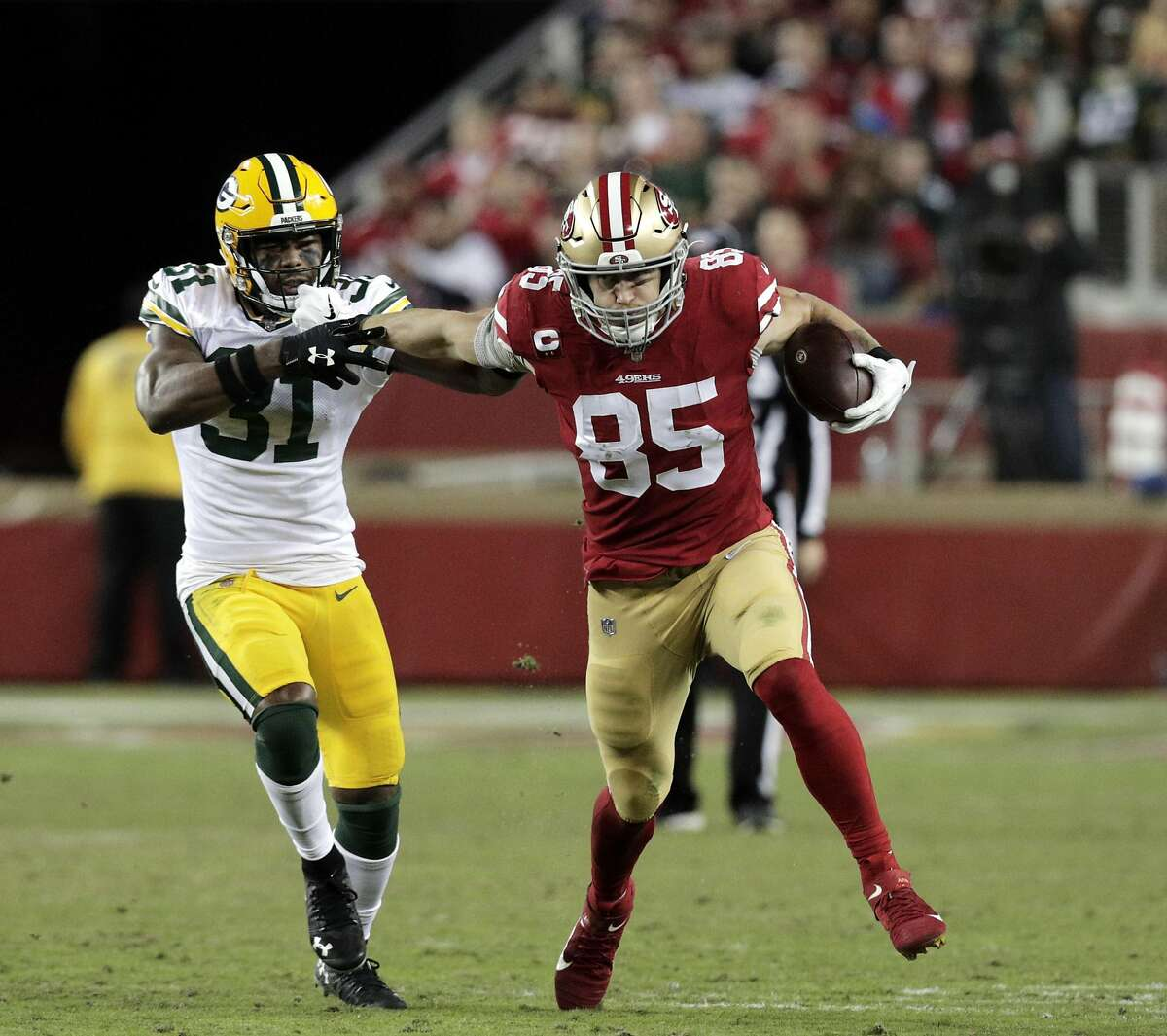 George Kittle (85) runs after a catch in the first half as the San Francisco 49ers played the Green Bay Packers at Levi's Stadium in Santa Clara, Calif., on Sunday, November 11/24/19, 2019.