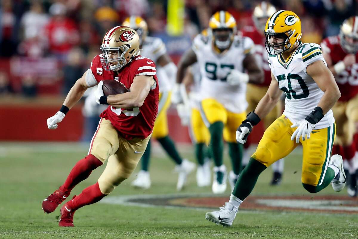 San Francisco 49ers' George Kittle runs after a catch against Green Bay Packers' Blake Martinez during NFL game at Levi's Stadium in Santa Clara, Calif., on Sunday, November 24, 2019.