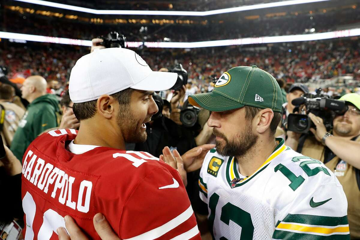 Green Bay Packers' Aaron Rodgers greets San Francisco 49ers' Jimmy Garoppolo after Niners' 37-8 win in NFL game at Levi's Stadium in Santa Clara, Calif., on Sunday, November 24, 2019.