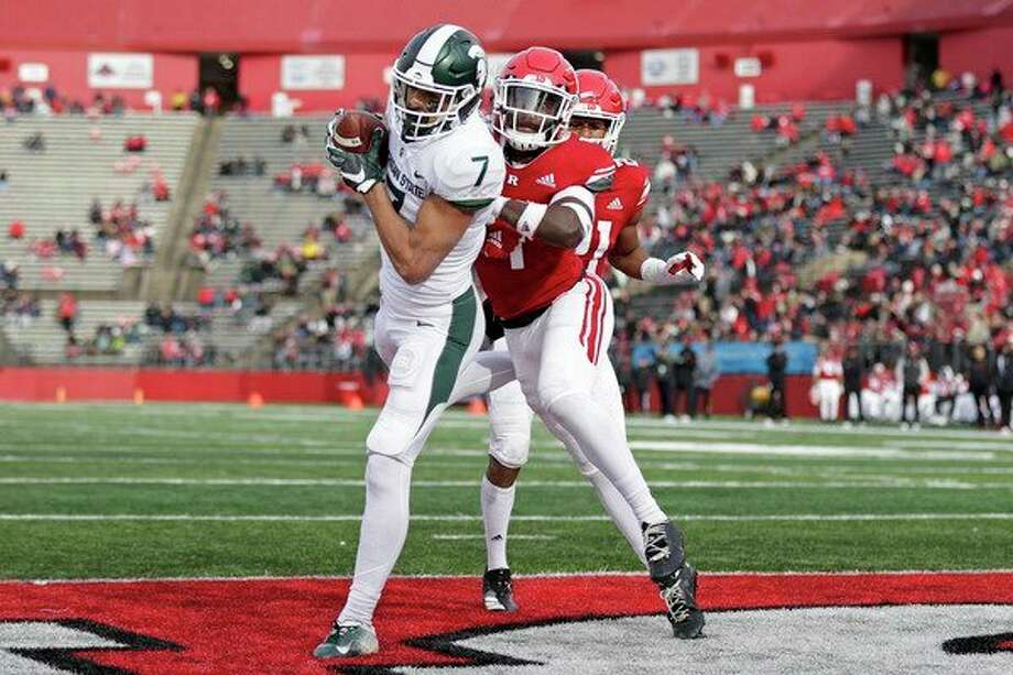 Michigan State wide receiver Cody White (7) catches a touchdown pass in front of Rutgers defensive back Tim Barrow during the first half of an NCAA college football game on Saturday, in Piscataway, N.J. (AP Photo/Adam Hunger) / Copyright 2019 The Associated Press. All rights reserved.