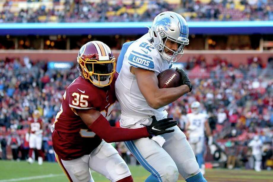 Detroit Lions tight end Logan Thomas (82) scores a touchdown on a pass from quarterback Jeff Driskel, not visible, as Washington Redskins free safety Montae Nicholson (35) tries to bring him down in the end zone during the second half of an NFL football game on Sunday in Landover, Md. (AP Photo/Alex Brandon) / Copyright 2019 The Associated Press. All rights reserved.