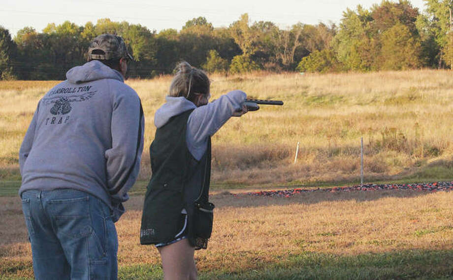 Coach Jim Cox helps Ella Richey, a member of Carrollton High School's trapshooting team, focus on her shot. Photo: Michelle Cox | For The Journal-Courier