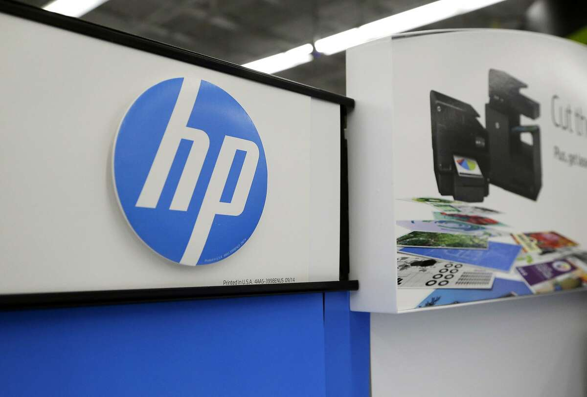 FILE - In this May 24, 2016, file photo, Hewlett-Packard products are on display at a store in North Andover, Mass.