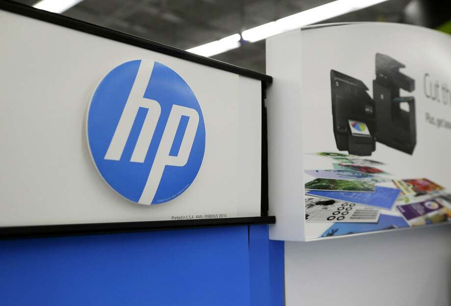 FILE - In this May 24, 2016, file photo, Hewlett-Packard products are on display at a store in North Andover, Mass. Photo: Elise Amendola, Associated Press