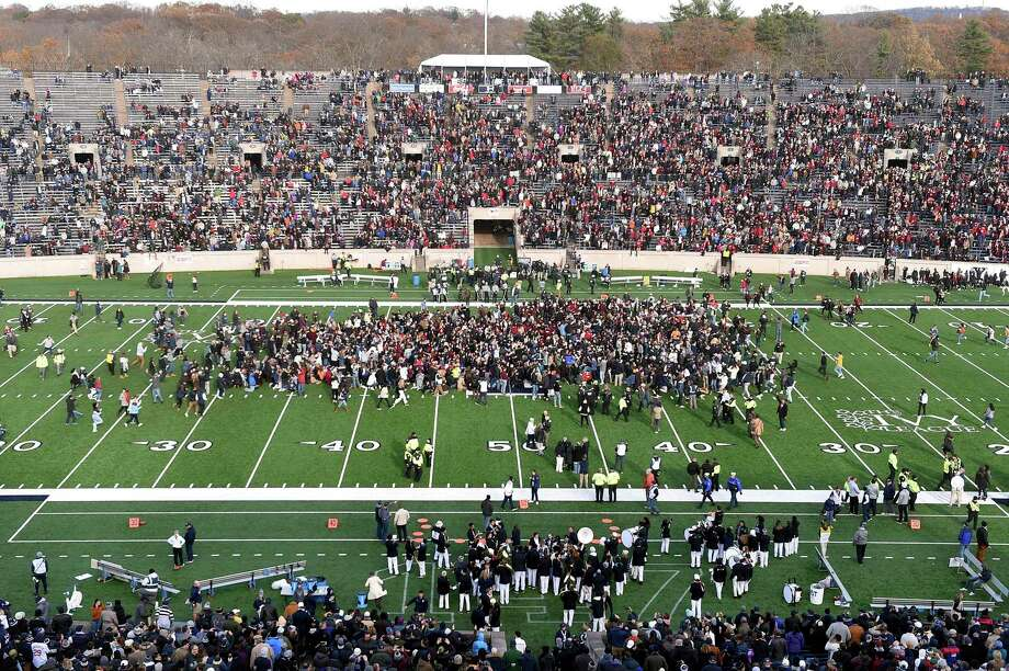 Demonstrators stage a climate change protest at the Yale Bowl, delaying the start of the second half of an NCAA college football game between Harvard and Yale Nov. 23, 2019, in  New Haven. Photo: Arnold Gold / Hearst Connecticut Media / New Haven Register