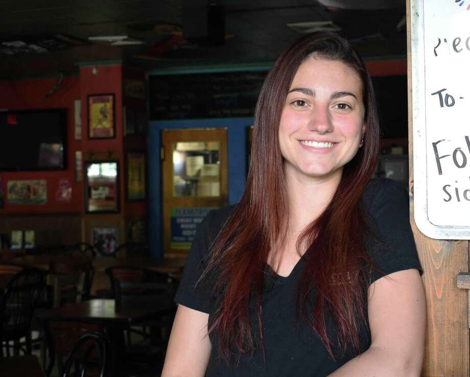 Danielle Kelly, a waitresses at Side Street Grille in Hamden, is also studying microbiology at Quinnipiac University. Photo: Alexis Guerra / Special To Hearst CT Media