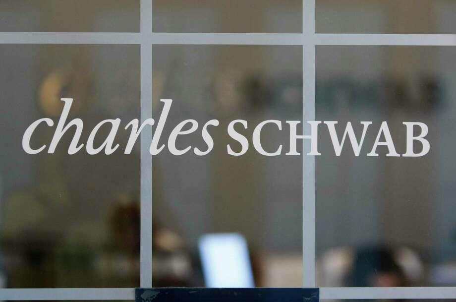 FILE - This July 14, 2010, file photo, shows a Charles Schwab office in Oakland, Calif. Charles Schwab is buying rival TD Ameritrade for $26 billion, a blockbuster deal accelerated by disruption in the online brokerage industry. The tie-up announced Monday, Nov. 25, 2019, would create a company so big, however, that it may draw sharp scrutiny from antitrust regulators.(AP Photo/Paul Sakuma, File) Photo: Paul Sakuma / Associated Press / AP2010
