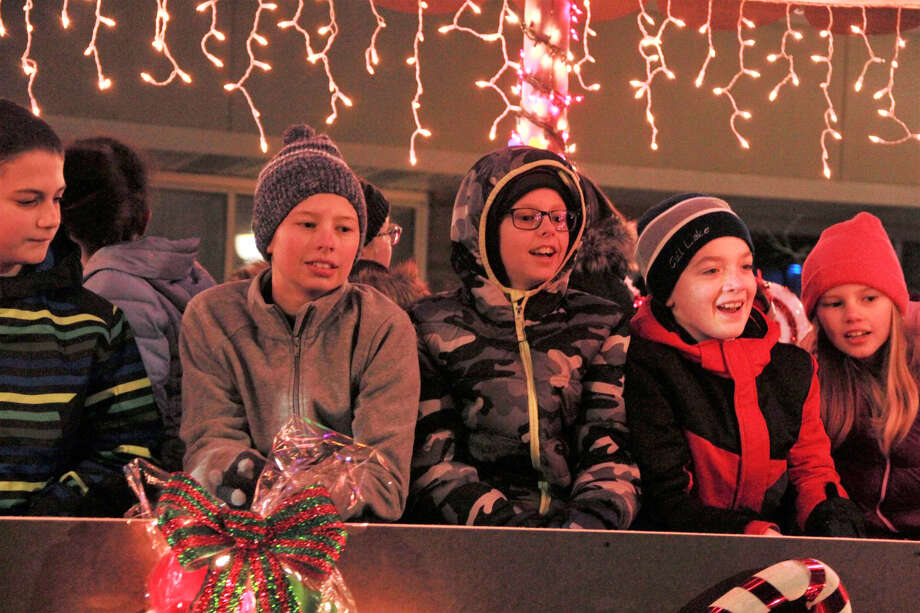 Area residents gathered in downtown Big Rapids as they watched the night come alive during the annual Festival of Lights Parade Saturday. During the parade, kids fill their bags with candy and everyone's eyes twinkled as firetrucks and floats rode down North Michigan Avenue wrapped in Christmas lights. Santa Claus made a special guest appearance at the end of the parade, with a ceremonial tree lighting. Photo: Pioneer Photo/Alicia Jaimes