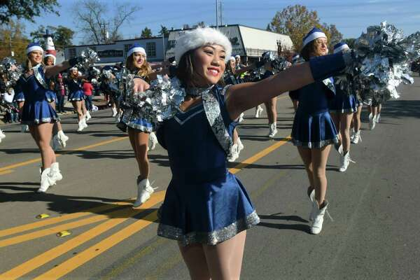 Tomball Memorial High School senior Lt. Kyah Nguyen and the Silver Stars perform as they move down Main Street during the 54th Annual Tomball Holiday Parade on Nov. 23, 2019.