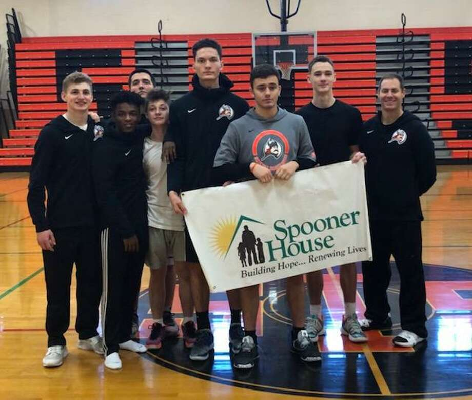 The Shelton High School Boys Basketball team in conjunction with Shelton Biddy Basketball held a free basketball clinic. Players were asked to donate non perishable items for Spooner House. Photo: Contributed Photo / Connecticut Post